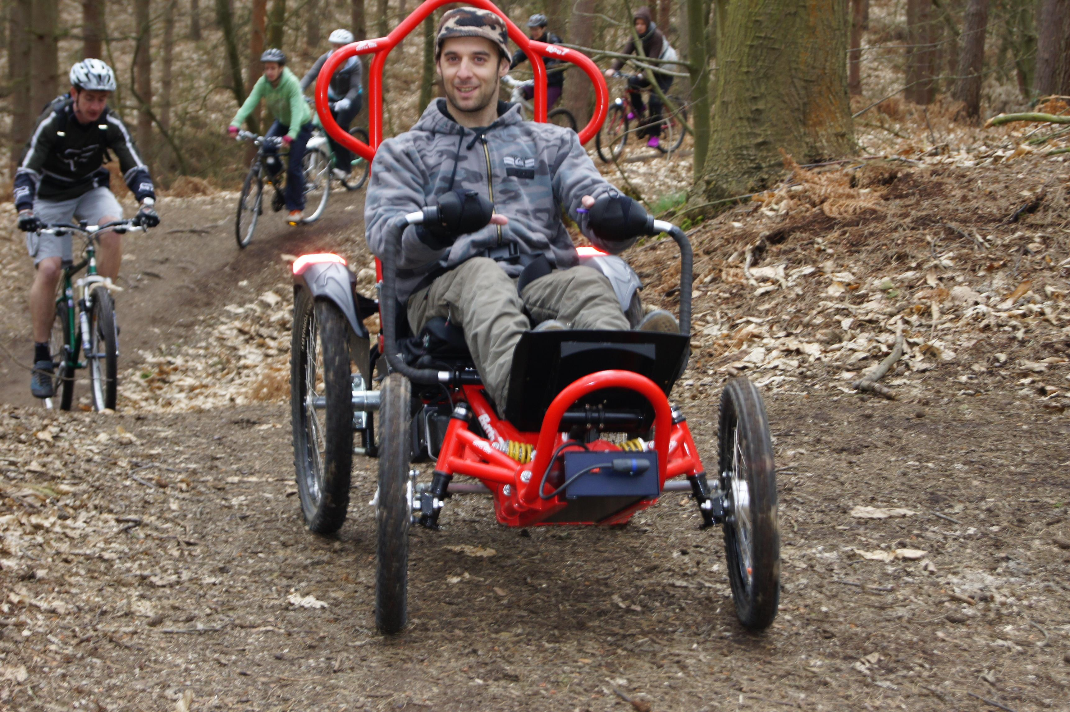 Molten Rock All Terrain Boma 7 Wheechair Being Enjoyed In Use on Woodland Track (Full Size)