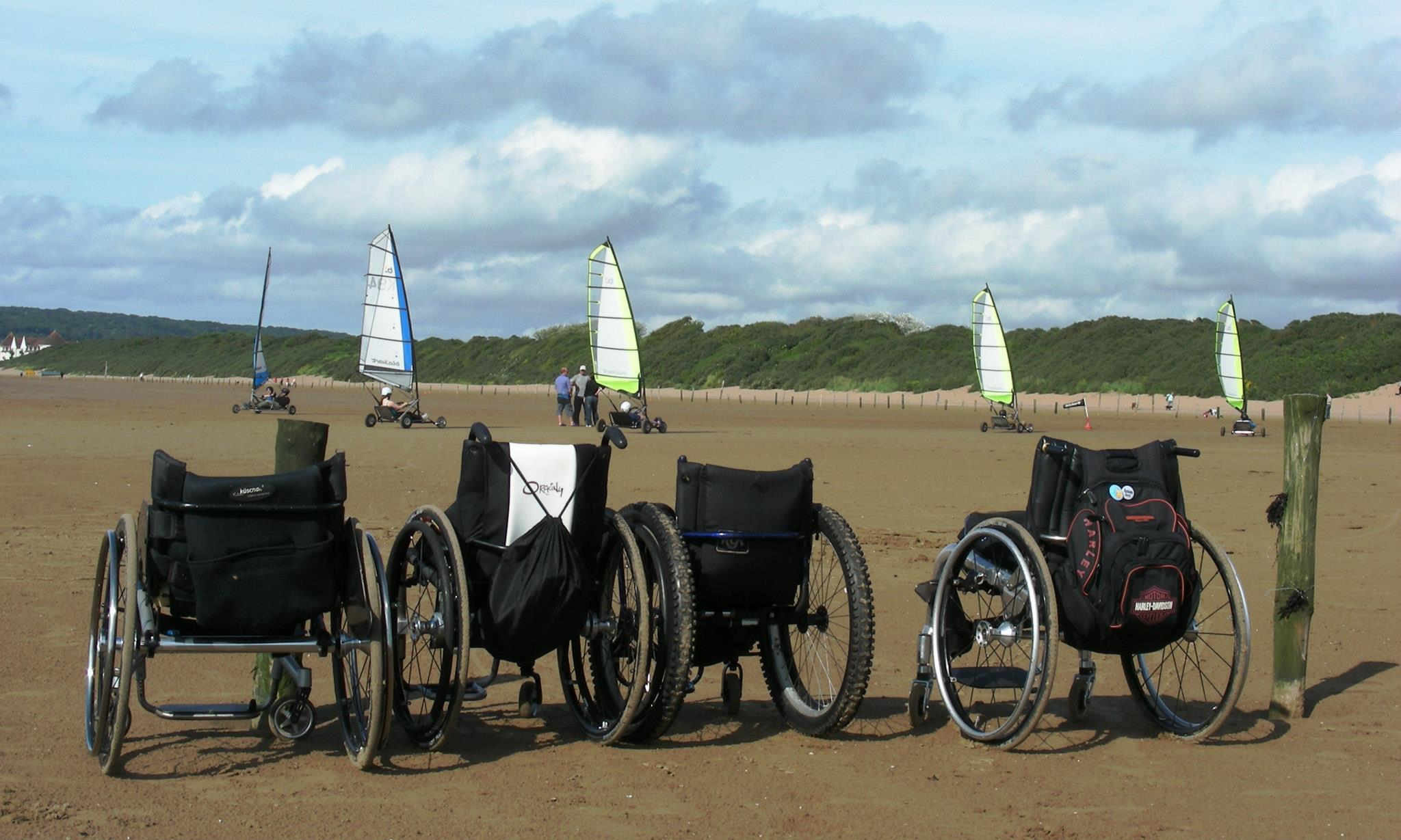 Wheelchairs on the beach (Full Size)